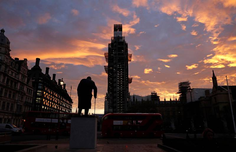 The sun rises as seen in Parliament Square with the statue of former Prime Minister Winston Churchill in the foreground in London, Wednesday, Nov. 14, 2018. British Prime Minister Theresa May will try to persuade her divided Cabinet on Wednesday that they have a choice between backing a draft Brexit deal with the European Union or plunging the U.K. into political and economic uncertainty. (AP Photo/Matt Dunham)