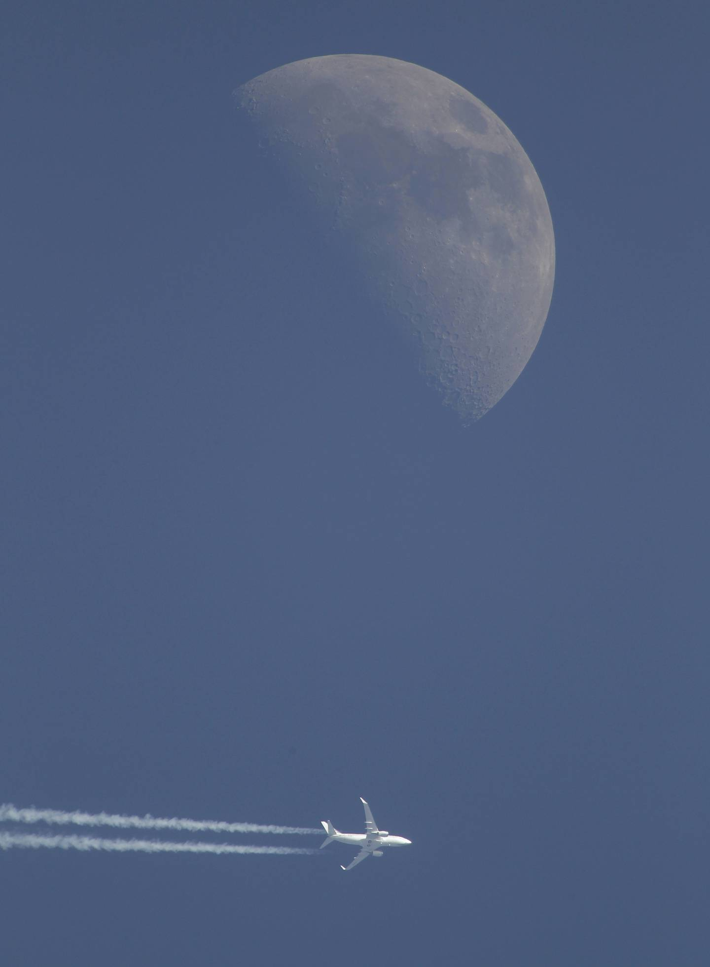 A jet airplane leaves a trail in the sky Sunday evening, April 29, 2012, over Novogrudok, 150 kilometers (93 miles) west of the capital Minsk, Belarus. The waxing crescent moon will be full May 6. (AP Photo/Sergei Grits)