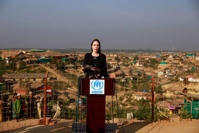 In this Tuesday, Feb. 5, 2019, photo, Hollywood actress Angelina Jolie addresses a press conference at Kutupalong refugee camp in Cox's Bazar, Bangladesh. Nearly 700,000 Rohingya, a persecuted Muslim minority in Myanmar, are living in refugee camps in coastal Cox's Bazar after fleeing their villages following a military crackdown. (AP Photo, File)
