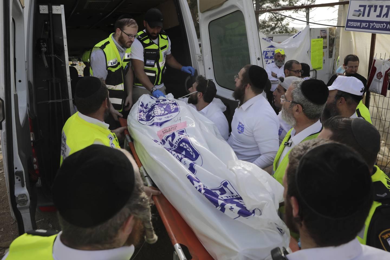 44 mennesker omkom og 150 ble skadd da det oppsto panikk og trengsel under en jødisk festival nord i israel torsdag. Foto: AP / NTB
